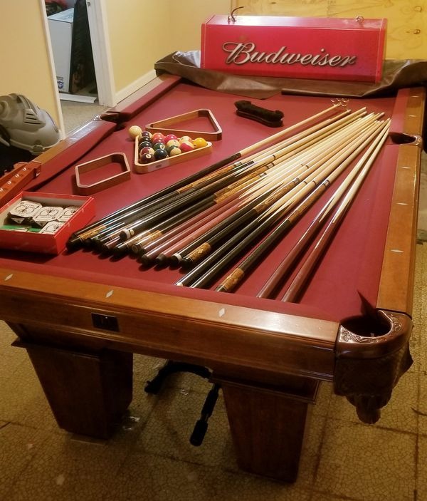 Competition Pool table very nice an complete have over 20 pool sticks all the racks ball ect an the Budweiser light that goes over top works always