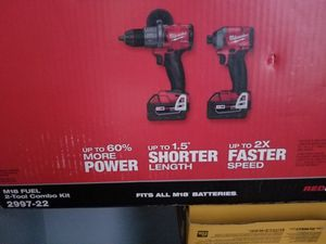 Milwaukee full hammer drill driver impact and charger 2 battery 5.0 for Sale in Chicago, IL