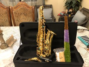 Fever alto saxophone with case mouthpiece neck strap cleaning cloth and gloves for Sale in Bell, CA