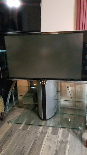 55 inch Samsung tv with table stand for Sale in Burke, VA