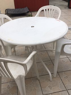 Metal Table And Plastic Chairs for Sale in Huntington Park,  CA