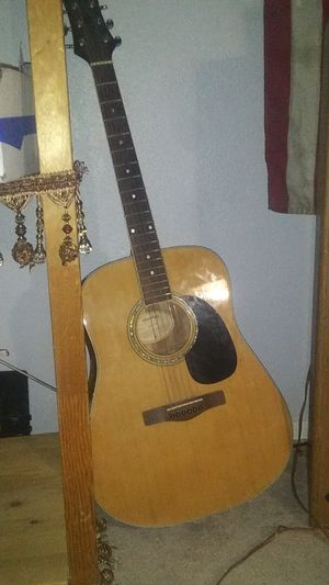 Light brown and black very nice like new mitchell acoustic guitar for sale. for Sale in Phoenix, AZ