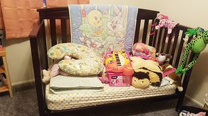 Toddler bed. Good condition, some bite marks. Comes with front rail. Mattress not included. for Sale in Saint Charles, MO