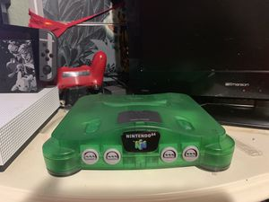 Jungle green Nintendo 64 With 11 games three controllers one rumble Pack for Sale in Dundee, FL