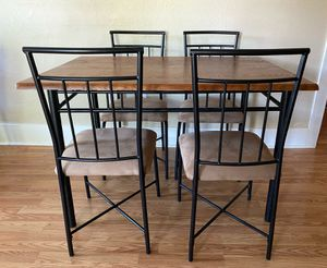 Wood Dining table with four chairs for Sale in Denver, CO
