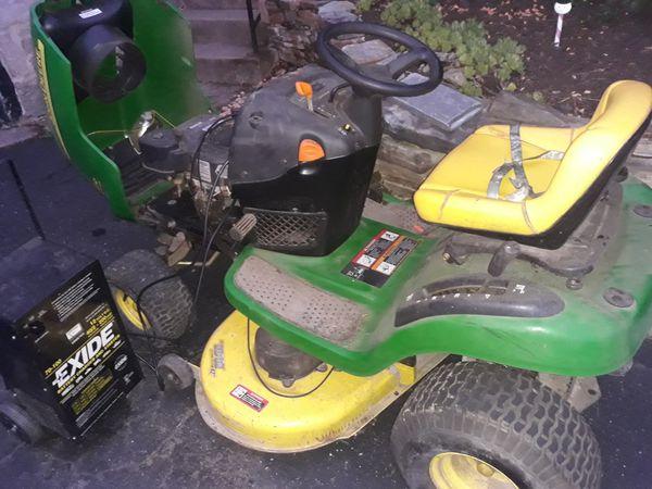 Jon deer riding lawn mower