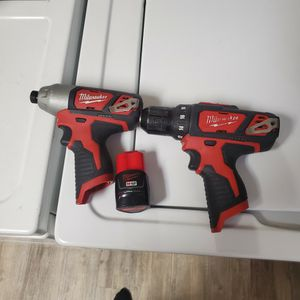 Milwaukee Drill And Impact Hex Driver & 1 1.5 AH Battery With M12 Charger for Sale in Lakewood, CA