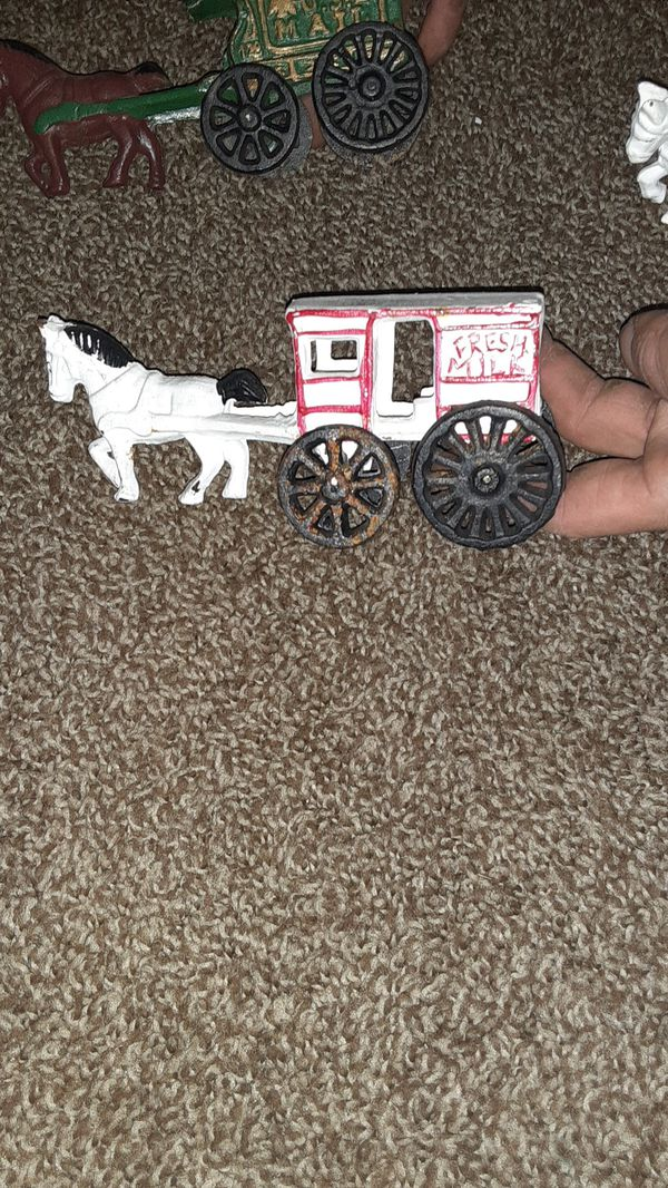 Cast iron porcelain buggie one mail , 2 ice buggies, fresh milk