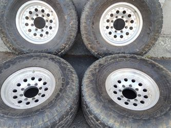 Set of four 16 inch aluminum rims and tires. 8 lugs, Chevy Ford Dodge for Sale in Pico Rivera,  CA