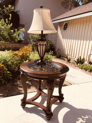 Signature Design by Ashley Norcastle Round End Table for Sale in Cypress, CA