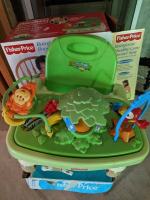 Fisher price rainforest theme booster seat for Sale in Cumming, GA