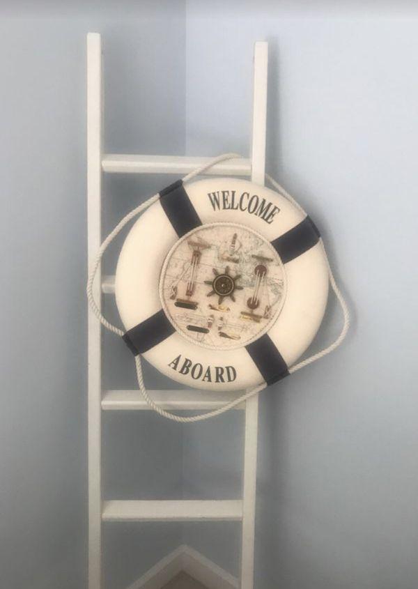 Ladder and decorative nautical buoy