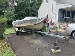 Microcraft 15 foot fishing boat. High wall with trailer and motor for Sale in Paramus, NJ