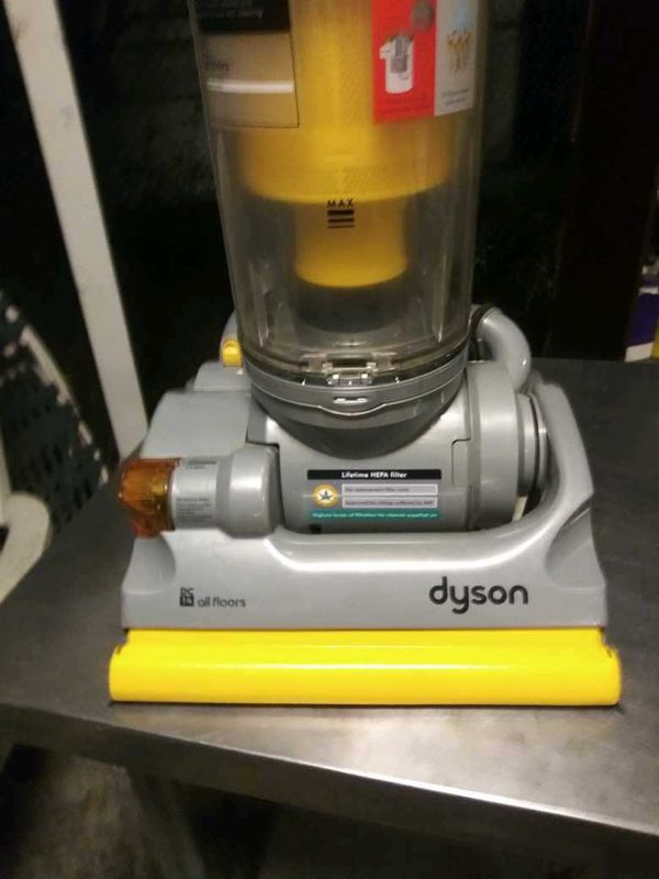 Dyson DC14 all floors vacuum, bagless and hepa filter.
