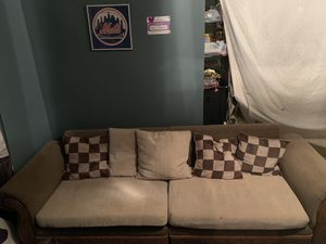 Simple light weight sofa , very wide seats , comfortable enough to sleep on, wear and tear ask for detailed pics if you'd like, it does split in the for Sale in Charles Town, WV