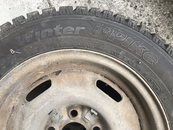 STUDDED TIRES QTY. 2 FOR SALE ON RIMS !!!!! FROM VOLVO 240 !!!!! 185 65 14 MAKE OFFER !!!!!