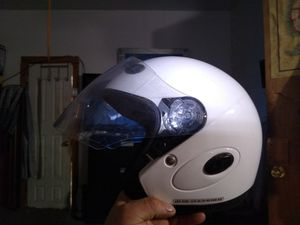 Two motorcycle helmets white one XXs black helmet extra large for Sale in Cuyahoga Heights, OH