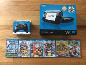 Wii U deluxe with 7 games and pro controller for Sale in Portland, OR