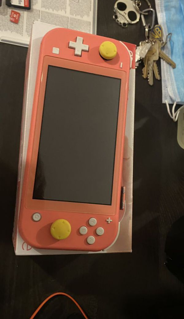 Coral Nintendo Switch Lite w/games and memory card