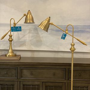 Gold floor lamp and Gold table lamp. Adjustable heights. some minor scratches. NEW with tags. MSRP $400. Our price $130 for both! for Sale in Woodstock, GA