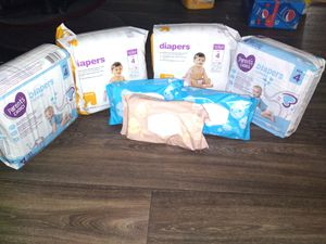 Brand new size 4 diapers 31 in each pack 3 wipes 72 in each pack all for $20 no less pick up only for Sale in Phoenix, AZ
