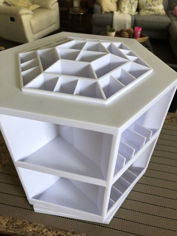 Cosmetic organizer in perfect conditions,no stains,no missing parts.Great for vanity space saver.