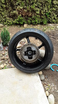 Triumph back motorcycle rim and tire for Sale in Portland,  OR
