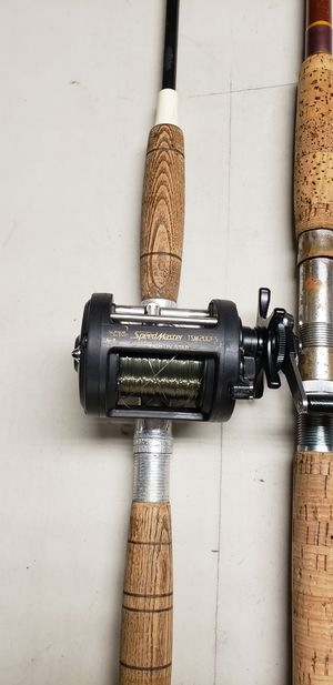 Fishing reel and 2 rods for Sale in Whittier, CA