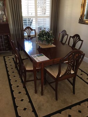 Duncan Phyfe style dining room table and 6 chairs. Includes one leaf and protective cover. Seats need recovering. for Sale in Land O Lakes, FL