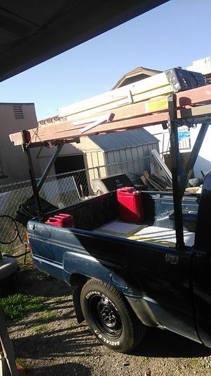 Ladder rack and ladders. With tie downs. $200 for Sale in Los Lunas, NM