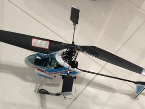 walkera helicopter w chager battery !!have at new parts! spare to !! w radiocontrole! need batery for Sale in Miami, FL