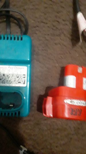 Makita fast charger and 12 v battery for Sale in Kansas City, MO