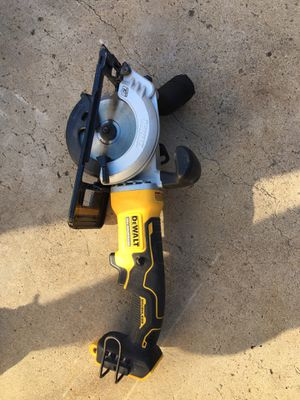 Dewalt mini skill saw 4 1/2 like new use one time no battery no charger work good no low offer for Sale in National City, CA