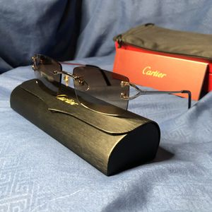 Cartier Silver Wire Frame Glasses With Dark Grey Tint Lenses for Sale in Warren, MI