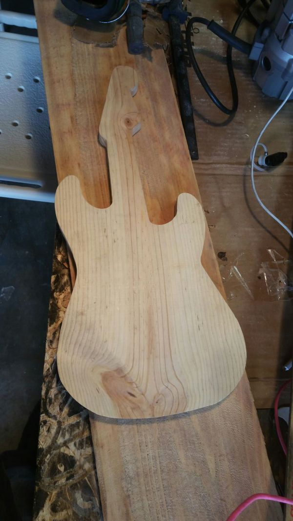 Wood guitar cutout