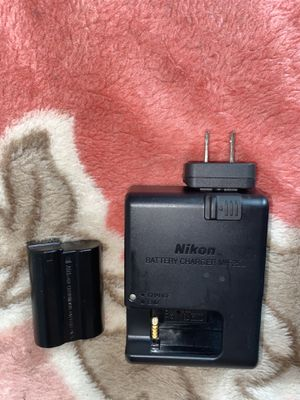 Nikon battery + battery charger for Sale in Brooklyn, NY