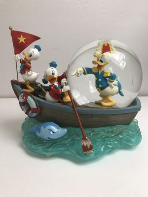 Disney snow globe Donald Duck and sea scouts in boat shark musical for Sale in Nashville, TN