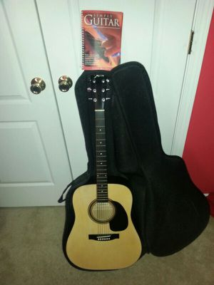 Acoustic guitar, pick, case, electronic tuner, learning book. for Sale in High Point, NC