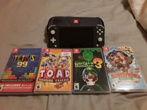 Nintendo Switch Lite, 256 GB memory card, carrying case, and 4 games. Like new. for Sale in Nashville, TN