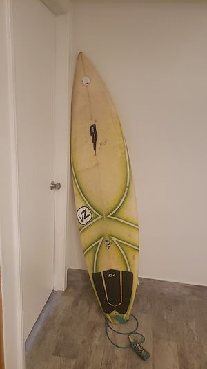 "Johnney b surfboard 6' 3"" good condition with fins and leash and Dakin foot for Sale in San Bernardino, CA"