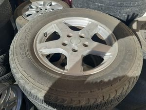 Set of Jeep grand Cherokee rims with good tires for Sale in North Las Vegas, NV