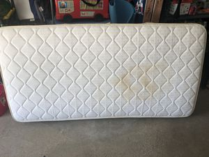 Twin mattress solid condition a few water stains for Sale in Wilmington, MA