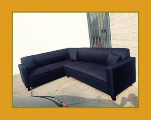 "new 7x9 ft ""Domino black"" sectional couches for Sale in Los Angeles, CA"
