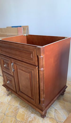 Bathroom vanity. 30 inches wide. Soft close door and drawers. Walnut solid wood. Purchased on amazon last year. $339 for Sale in Redlands, CA