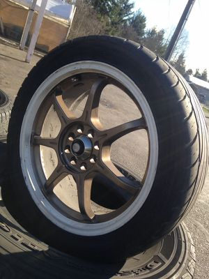 """Gold 17"""" rims and tires for Sale in Tacoma, WA"""