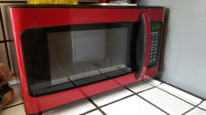 Red kitchen microwave and canisters and utensils holder for Sale in Modesto, CA