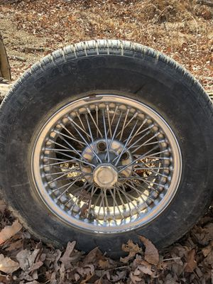Jaguar wire spoke wheels. Have 4. With or without Pirelli tires for Sale in Hedgesville, WV