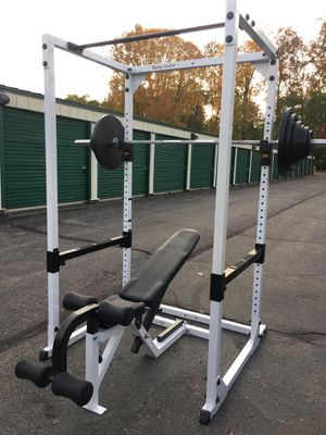 Body Solid Power Rack with 300lb Olympic Weight set and Weight Bench with Tuff Stuff Weight Tree for Sale in Belleville, MI