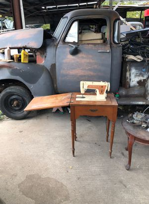 singer antique sewing machine with cabinet needs freshening up been in storage 30 years for Sale in Houston, TX