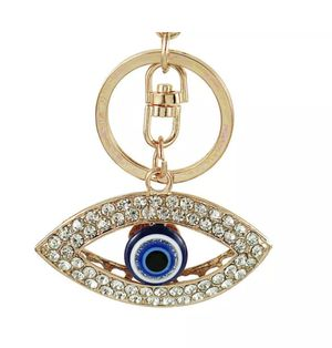 GOLD CRYSTAL EVIL EYE PURSE BACKPACK TAG KEYCHAIN . for Sale in Macomb, MI